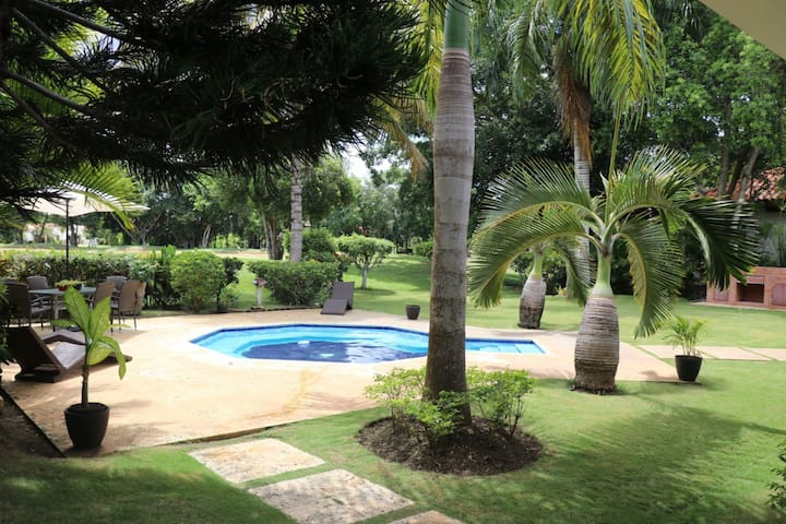 Secluded Tropical Garden with Golf View Near Beach