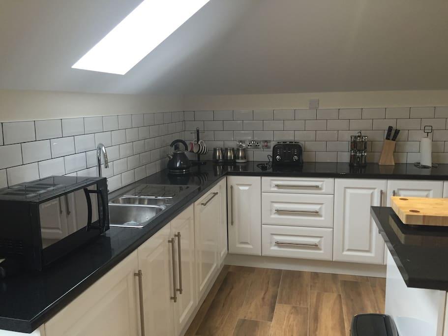 Kitchen with microwave, fridge, dishwasher, washing machine/dryer, cooker. All crockery, cutlery, glassware provided