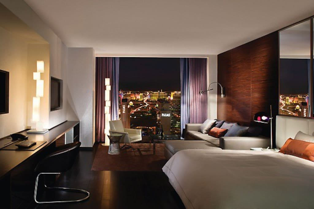 View in the condo in the evening. Sleek and modern. STRIP VIEW FACING SUITE