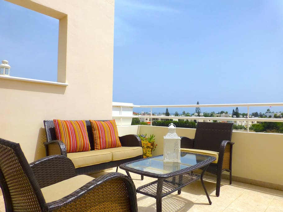 Sun Terrace With Sea Vies, Comfy Seating, Outside Dining Chairs And Table And Sun Beds.