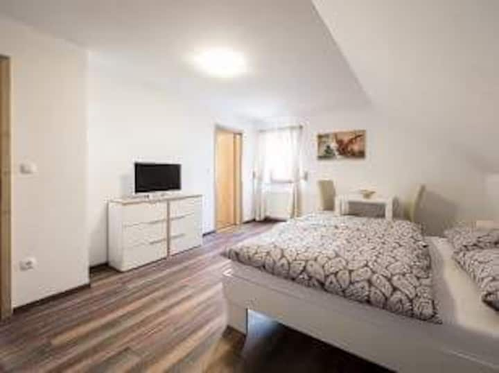 Double room with bathroom ,fridge,tv, sauna use