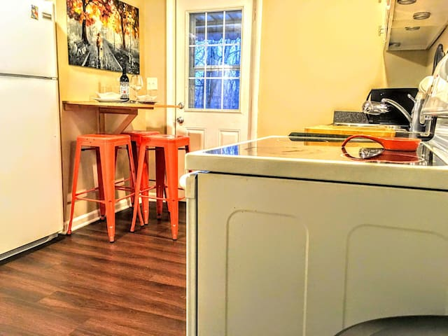 Sparkling clean and compact, eat-in kitchen with glass top, electric stove and oven combo.