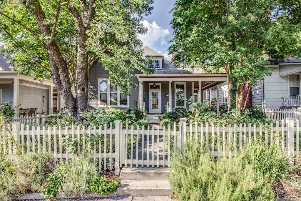 A sweet picket fence welcomes you home.