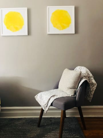 Even though there are 50 shades of gray in your room, you can still enjoy a bit of artistic sun framed on the wall.