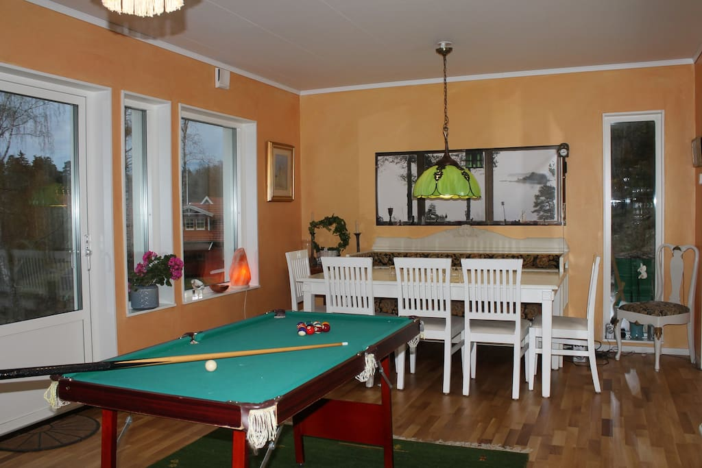 Dining room with small billiard table