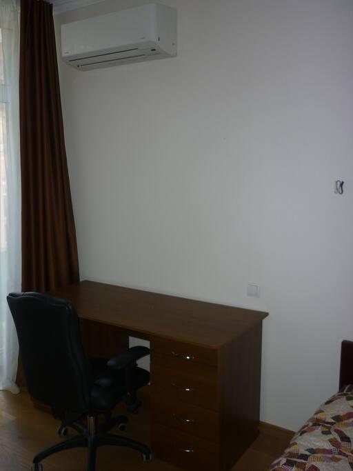 Desk, armchair, conditioner