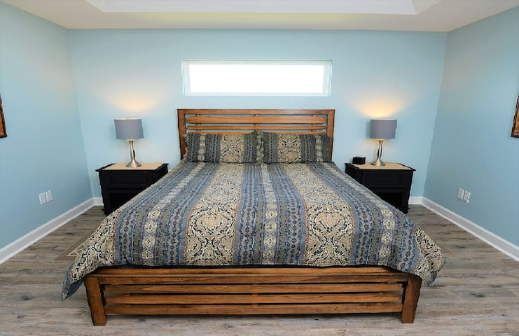 The master bedroom. All queen sized mattresses are upgraded pillow-top mattresses.