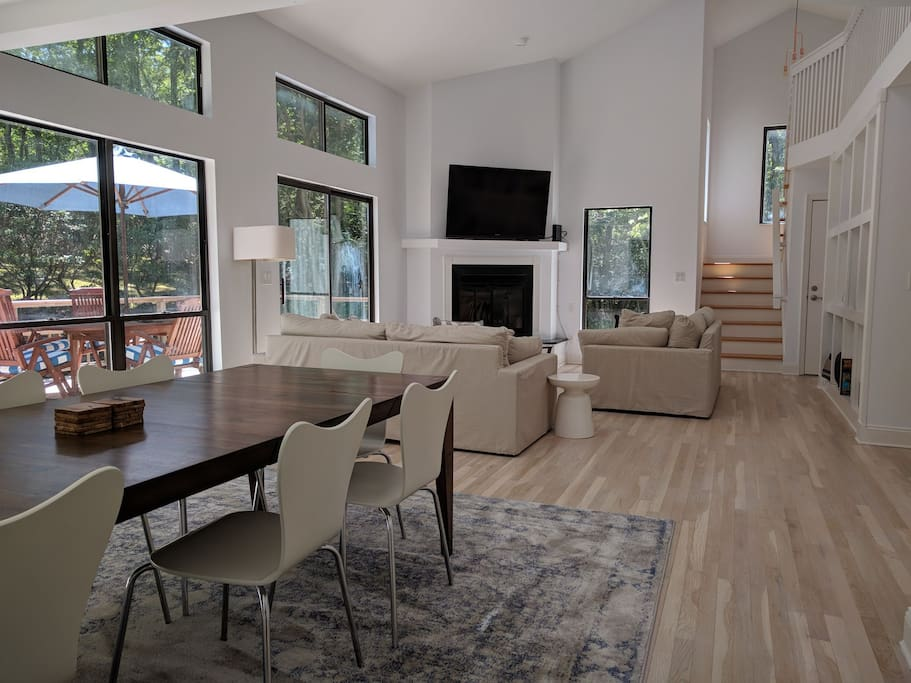 Spacious living dining area with cathedral ceiling