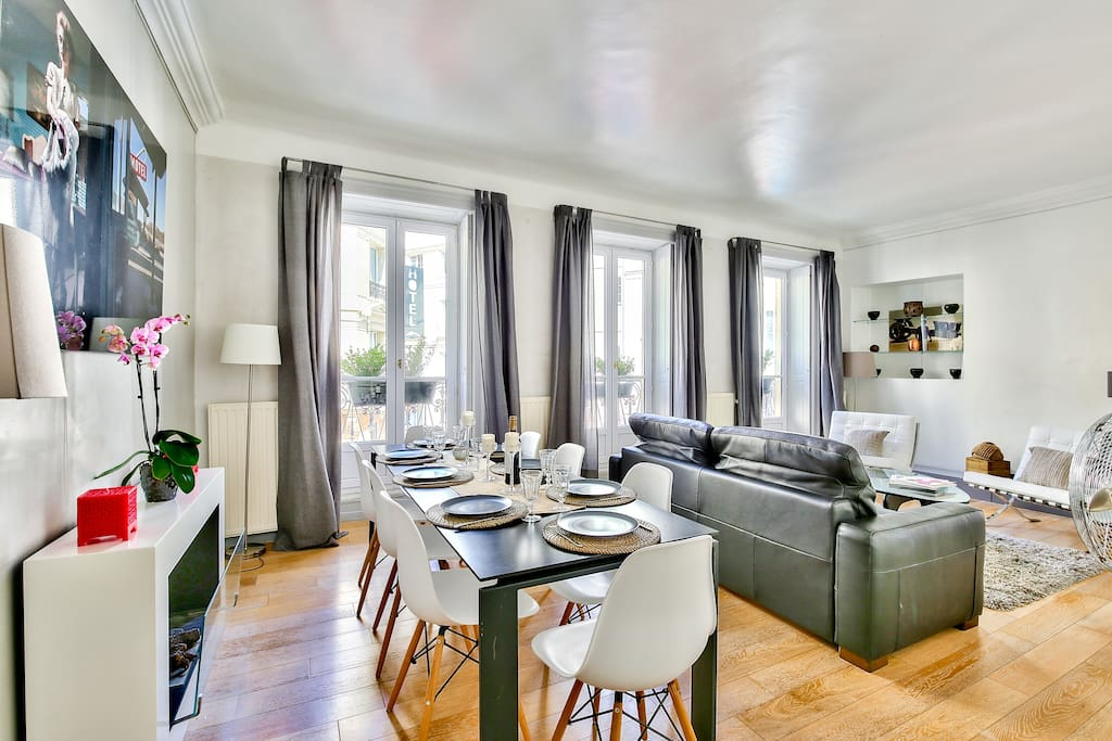 The living room with the dinning table is very sunny