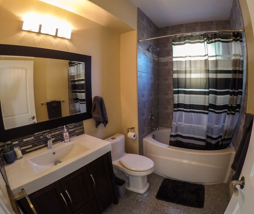 Full bathroom with large, deep tub for soaking or showering. Basic toiletries are provided.