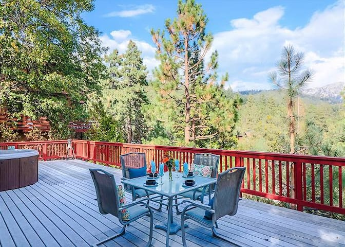 Large spacious deck with outdoor dining and spa.