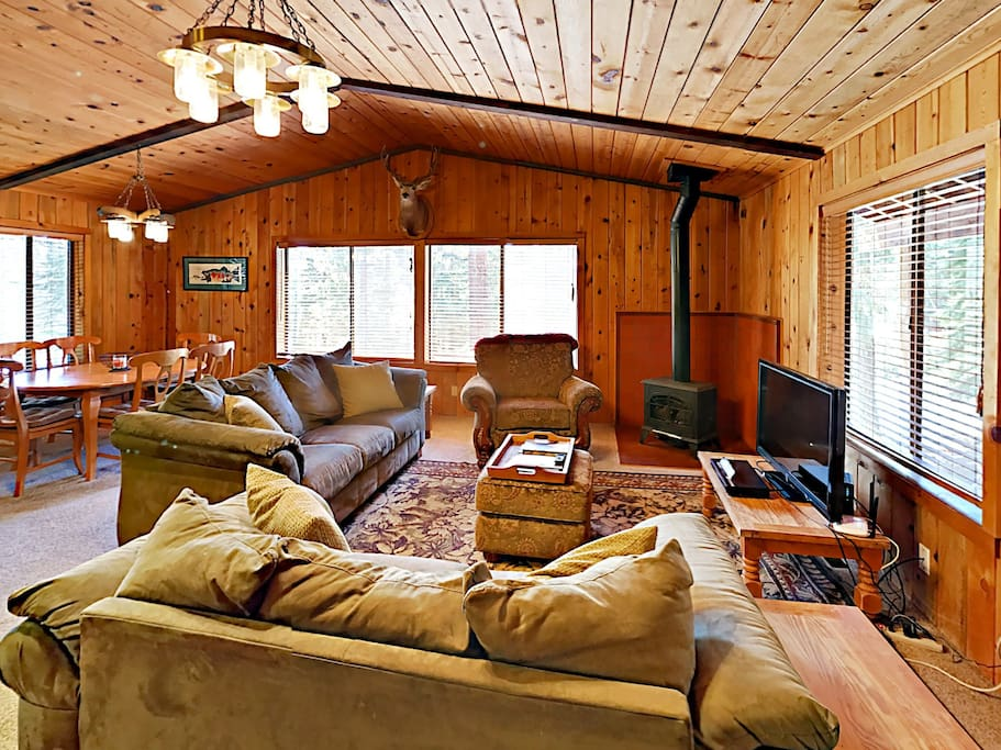 The main living area is an open space with fantastic lofted ceilings, a flat-screen TV and a cozy fireplace.