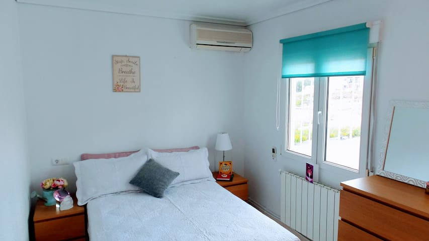 Master Bedroom with air con and private balcony