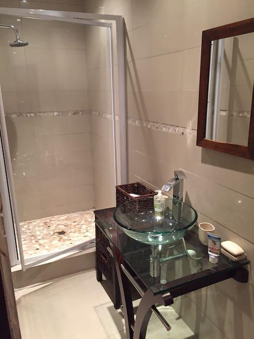 Bath Room: shower, basin and toilet.