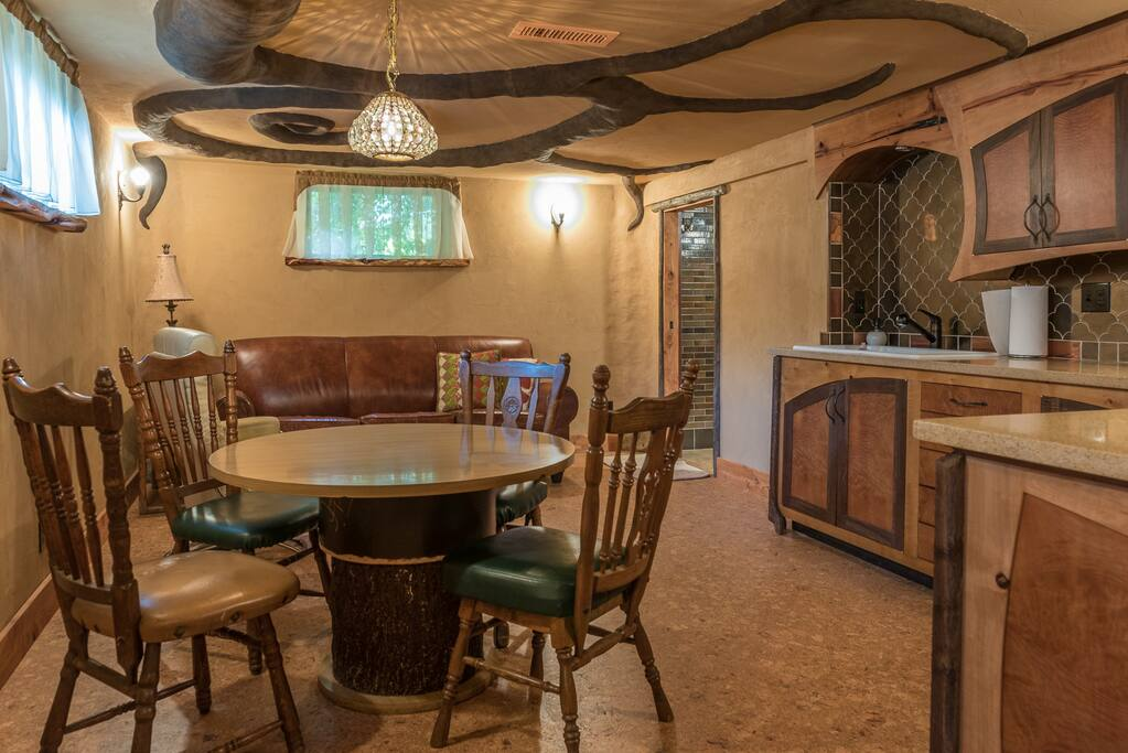 Your delightful Hobbit Hole includes kitchenette, living and dining rooms plus a spacious bathroom and deluxe queen bed and additional foldout sleeper sofa with memory foam mattress
