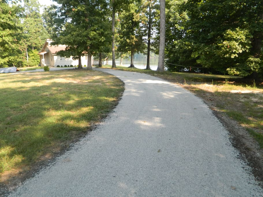 Gravel driveway to house from cul-de-sac
