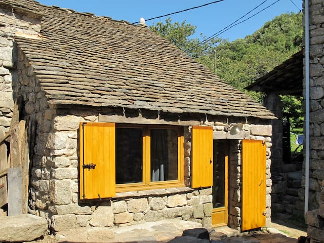 Idyllic small stone house in the hamlet Le Chambonnet