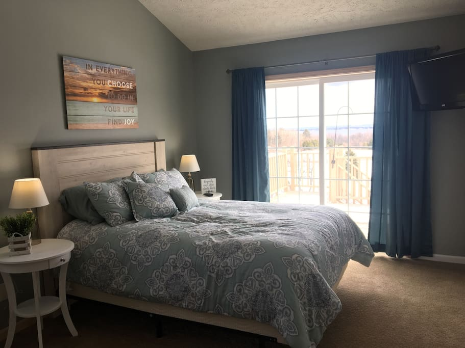 Updated bedroom, queen size bed with a magnificent view. USB charging station at bedside.