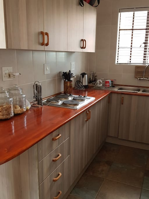 Kitchen with stove, microwave etc