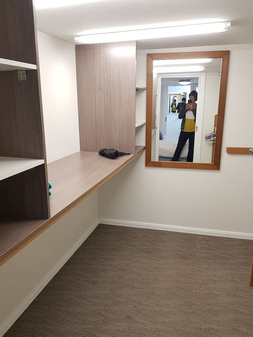 very large walk in wardrobe, with sliding door, can act as second bedroom for a baby