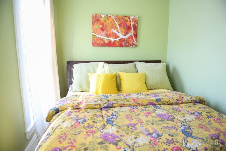 Comfy king bed with photo I took of the Maine blueberry barrens in fall.