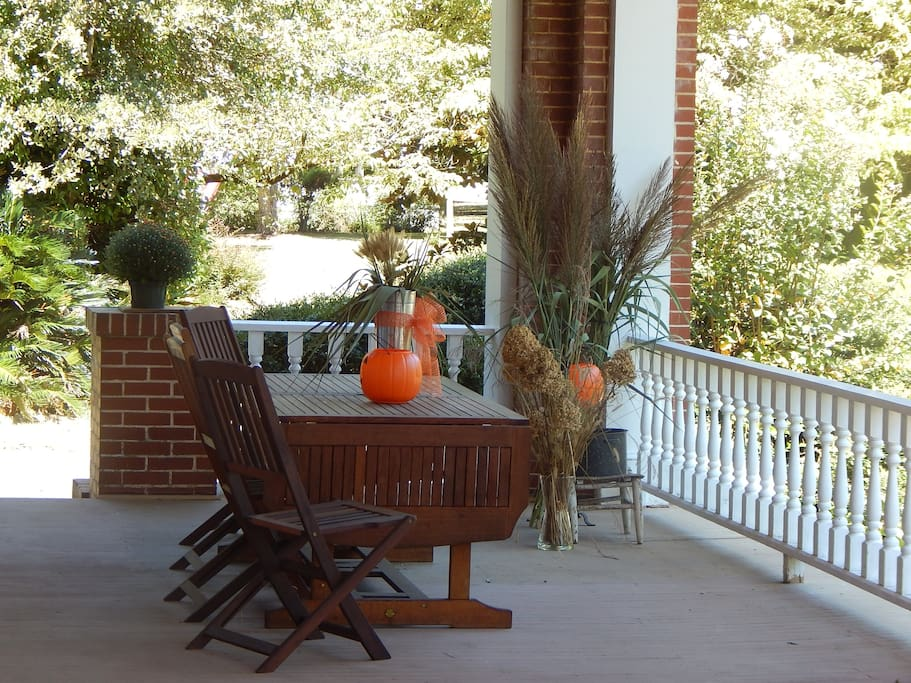 front porch with tables and seats.