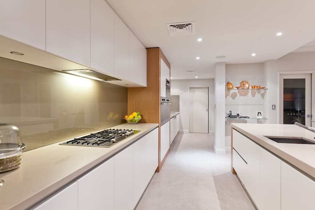 Kitchen and scullery through to laundry