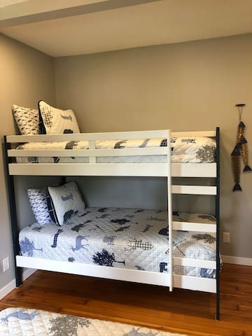 Second bedroom with bunk beds and a queen bed.