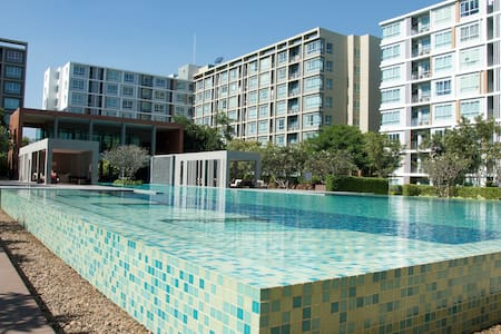 New condo, cozy resort style with enormous pool - Condominium