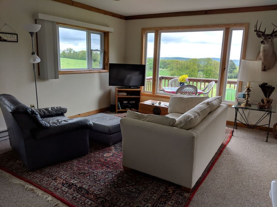 Living room with large window showing unobstructed view