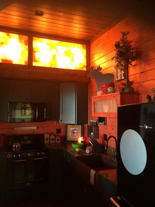 Salt lights are a glow in the equisite custom kitchen.