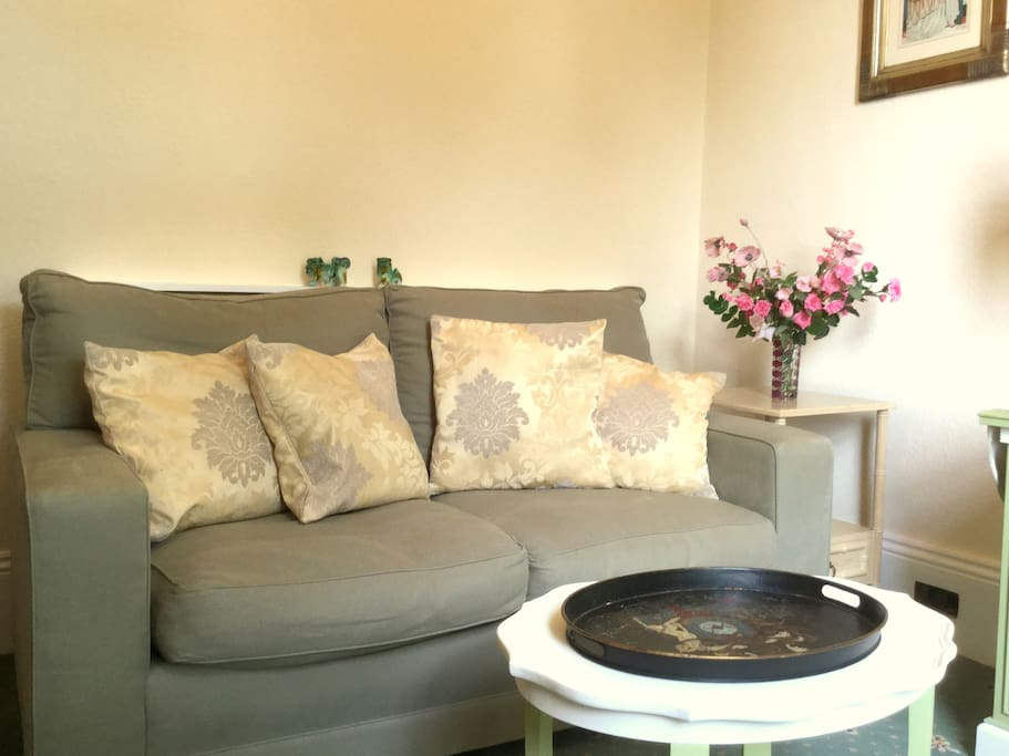 Sitting room contains a comfortable sofa
