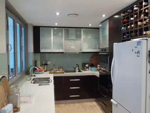 Miele Appliance Modern Kitchen access to balcony