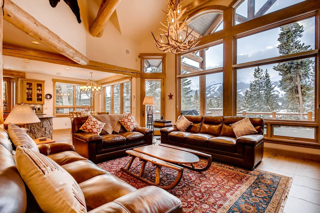 with large windows overlooking the majestic Breckenridge mountains