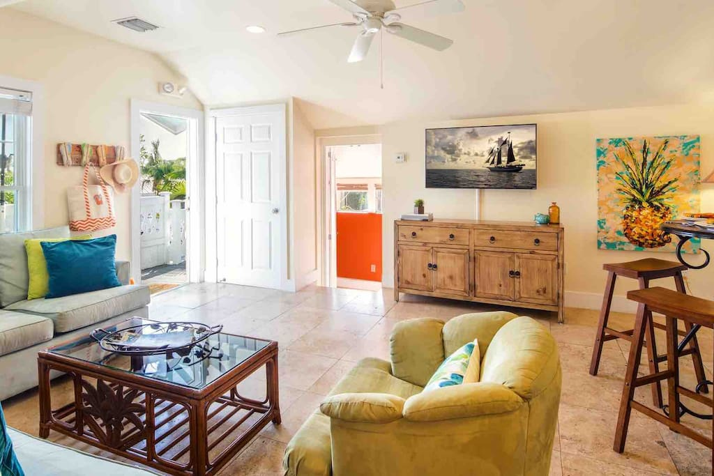 As you enter the apartment, you'll be greeted with a comfortable living room area...