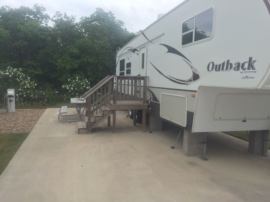 Typical 5th Wheel Travel Trailer  on concrete pad with steps!