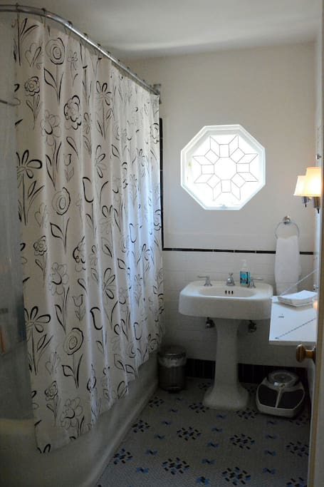 Original 1920s bathroom, fully updated with extra large tub/shower combo; charming built-ins; 2015 American Standard toilet