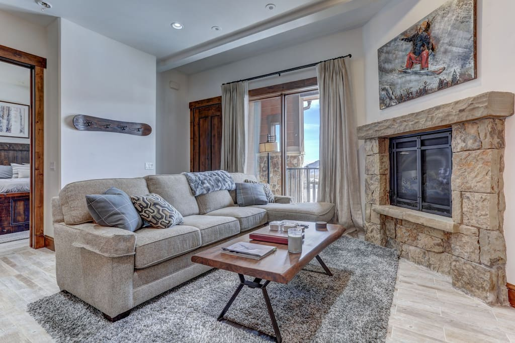 """Living Room with Gas Fireplace, 55"""" Smart TV, Balcony Access"""
