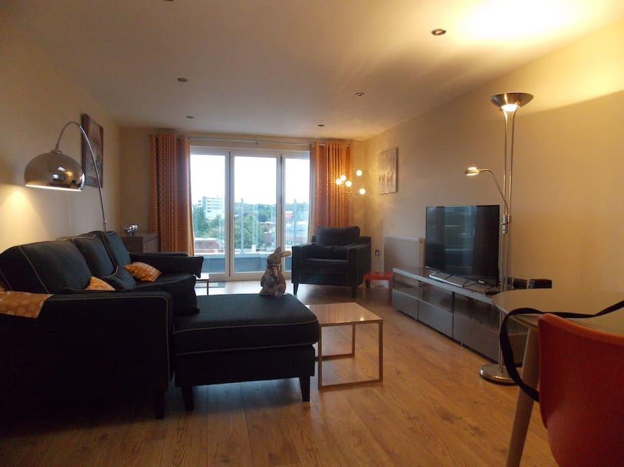 Living Area with door to balcony