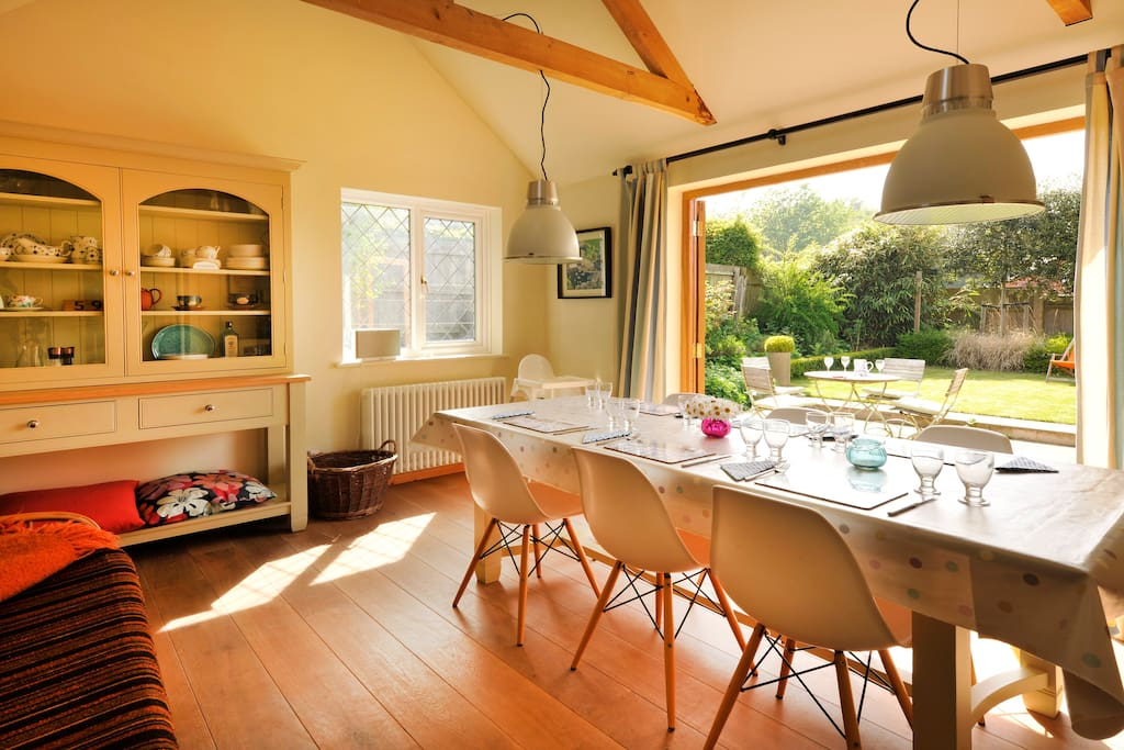 large dining room with studio couch - opens out on to beautiful safe landscaped gardens