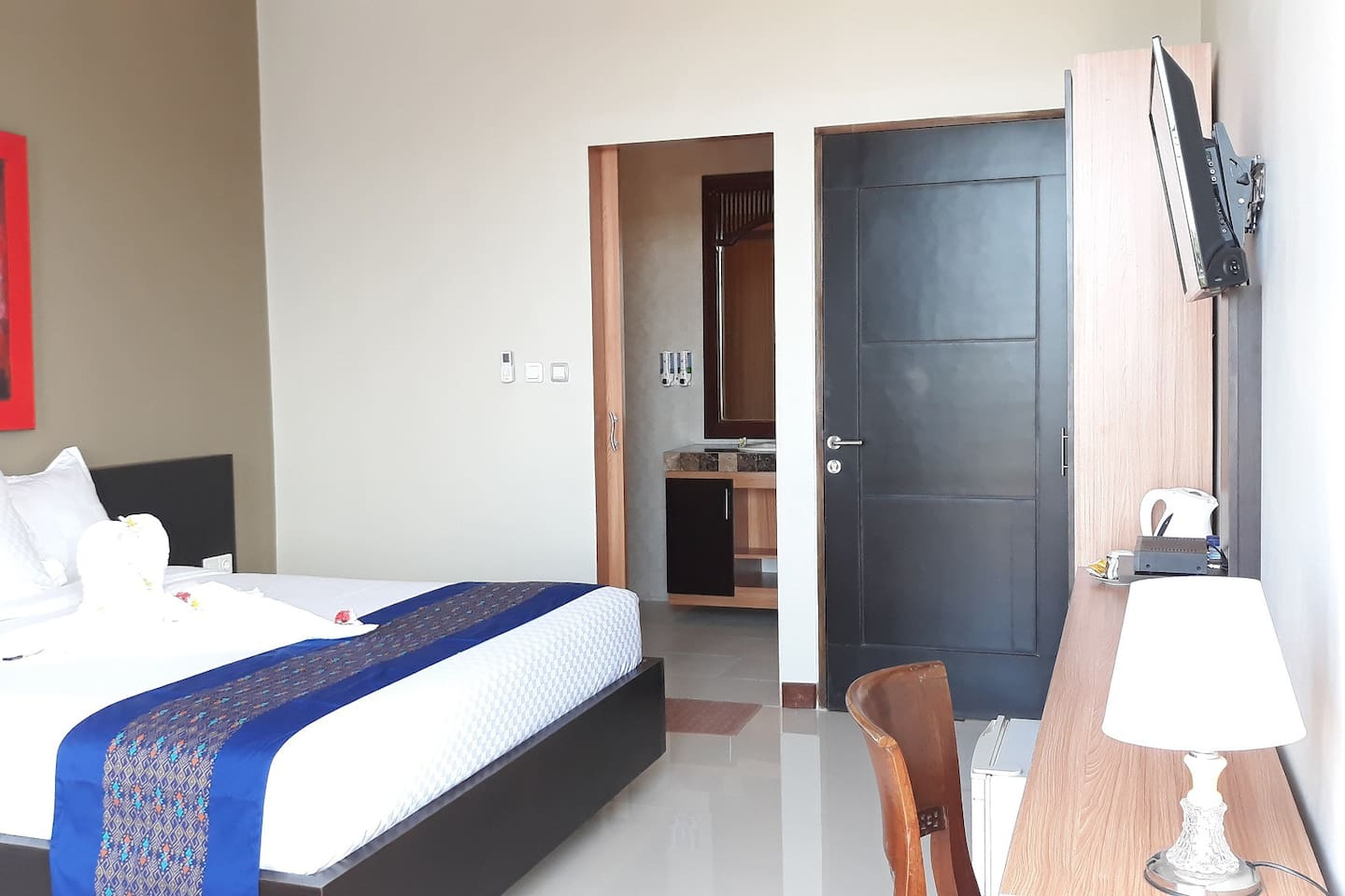 Spacious room  completed with balcony, rain shower, hot water, bath amenities,towels, TV cable channel, free internet connection, air condition.