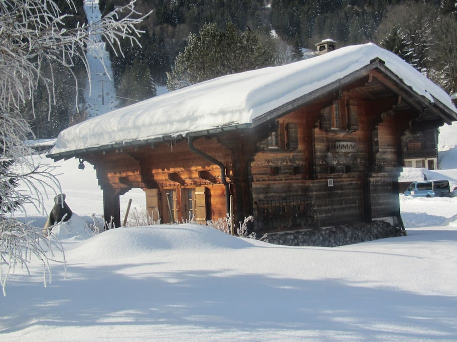 Chalet in winter with  Meillerets chairlift close-by