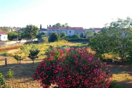 Antique house surrounded by beautiful nature - Rakalj