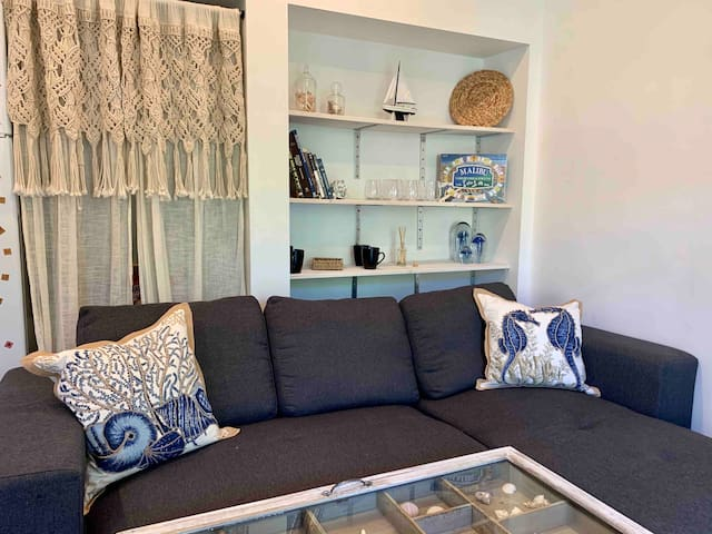 Grab a glass of your fave beverage, play some Malibu Monopoly, read a great book, or get lost looking at the jellies! Whatever your fancy this is a super comfy yet classic plus has all the storage you need for the queen sleeper sofa it turns into!