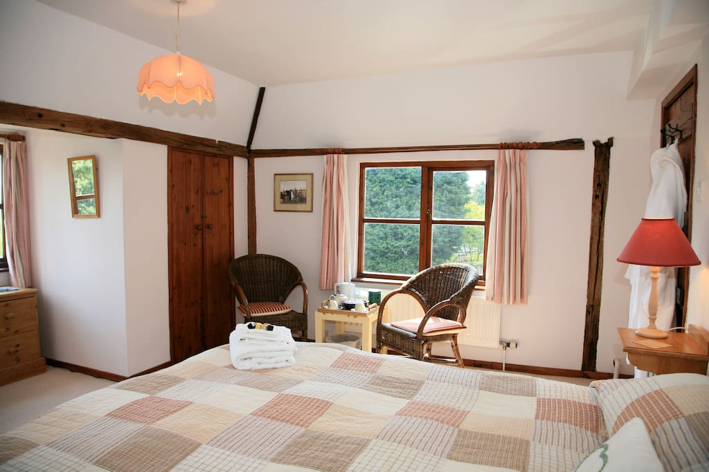 Pine bedroom with triple aspect