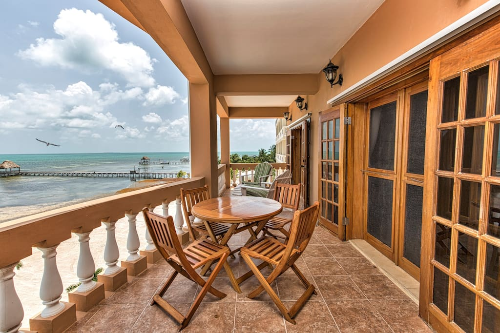 Balcony features both lounging AND dining furniture!