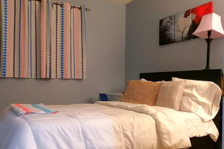 Full size bed room, TV and small study table