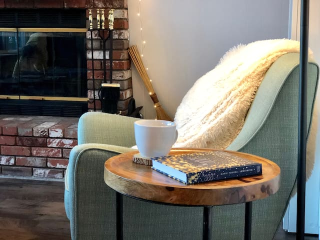 """A cozy reading spot - perfect for gazing out the window and enjoying a cup of tea. """"The house definitely lives up to the pictures! It's really adorable and the perfect weekend escape."""" - Meghan, guest"""