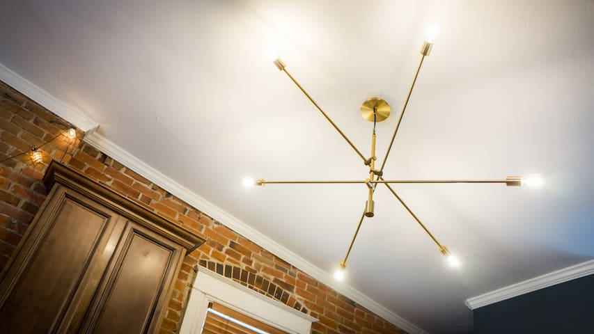 The grand mobile chandelier brightens the space with warm LED lighting.