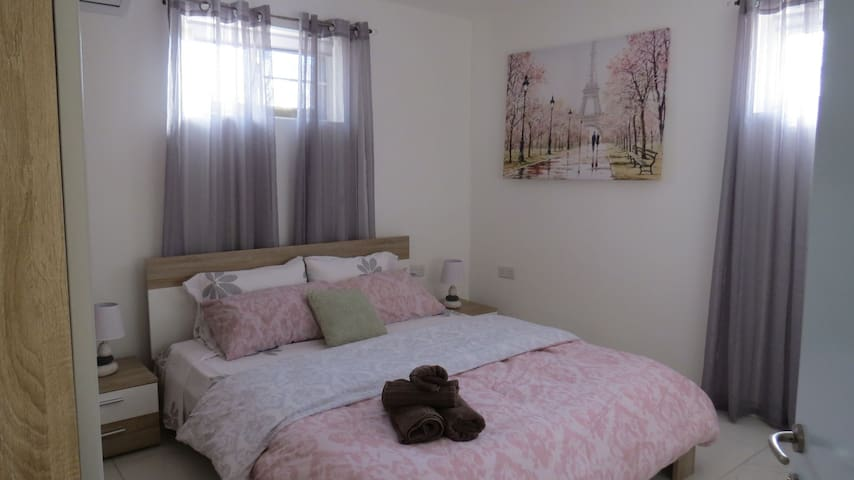 Main bedroom with a full size wardrobe and chest of drawers.